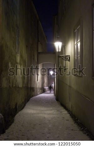 Shadow Silhouette at the End of Old Narrow Street. In the Winter and Night, Prague, Czech Republic - stock photo