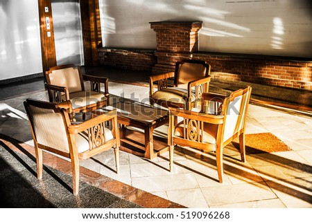 Shadow The light shines Table and empty wood chair in reception room area .