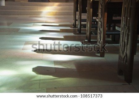 shadows in the church and colored reflections