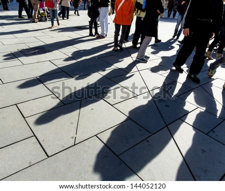 shadows of people, symbolic photo for anonymity, city life, mass society - stock photo