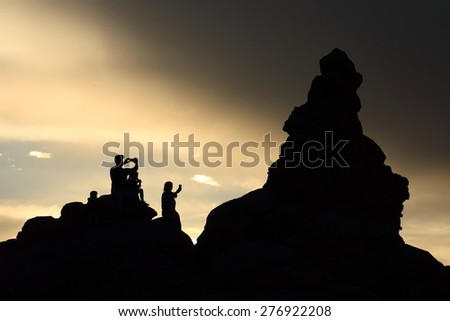 Shadows of People taking Pictures in the Mountains - stock photo