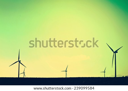 Shadows of windmills on the field. Vintage instagram picture. Alternative energy. - stock photo