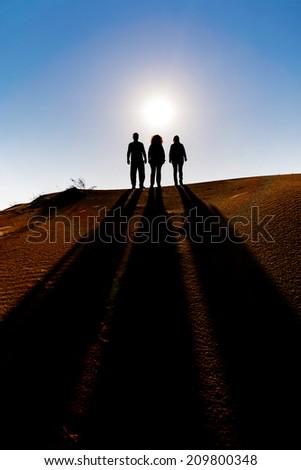 Shadows on the sandy beach - stock photo