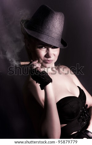 Shadowy Underworld Portrait Of A Striking Woman Wearing Detective Hat Smoking A Fat Cigar With A Cheeky Mysterious Grin In The Black Shadows Of Darkness