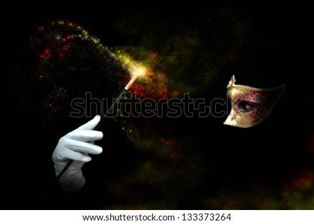 Shady lady making passes with magic wand - stock photo