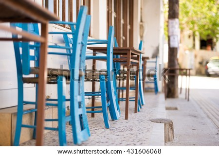 Shady place with table and chairs in the village Pitsidia in the south of Crete. Pitsidia is situated in the south of the Ida mountain range close to Matala. A nice little village and destination - stock photo