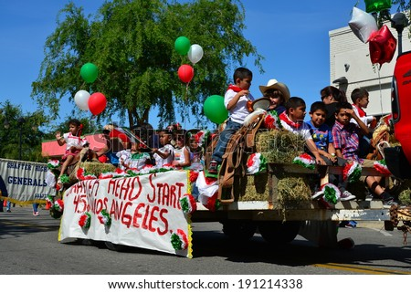 SHAFTER, CA - MAY 3, 2014: The children of the Head Start program ride on a float on a hot day during the Cinco de Mayo Celebration parade. - stock photo