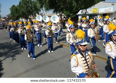 SHAFTER, CA - MAY 4: The Richland High School band plays for the spectators and proudly marches during the Cinco de Mayo Festival parade on May 4, 2013, at Shafter, California. - stock photo