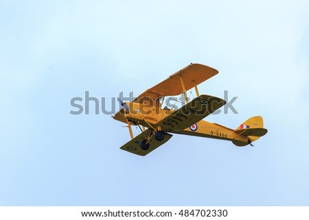 Shaftesbury, England - 19 August, 2016: A vintage Tiger Moth in Wiltshire, England.  This biplane dates from the 1930's and was used to train World War 2 pilots
