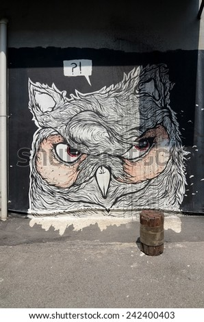 "SHAH ALAM, MALAYSIA-JANUARY 7: Street Mural tittle ""Owl"" painted by  by Cnvsstore  in Shah Alam on January 7, 2015. It was painted in conjunction with the 2014 Street Art Selangor Festival"
