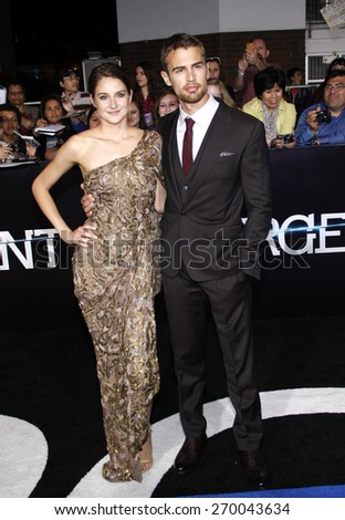 "Shailene Woodley and Theo James at the Los Angeles premiere of ""Divergent"" held at the Regency Bruin Theatre in Westwood on March 18, 2014 in Los Angeles, California. - stock photo"