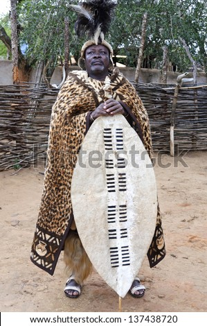 SHAKALAND, REPUBLIC OF SOUTH AFRICA - AUGUST 27: Zulu man in traditional clothes on August 27, 2009 in Shakaland, South Africa. The Zulu are the largest South African ethnic group - stock photo