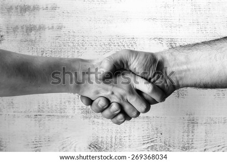 Shaking hands background, black-and-white, selective focus - stock photo