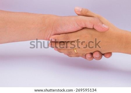 Shaking hands of two male and female, isolated on white - stock photo