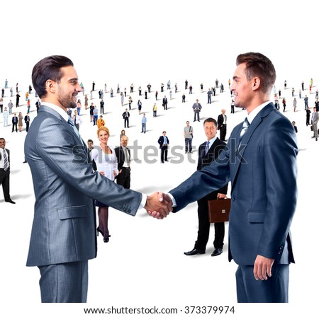 shaking hands on a background of a large group of people - stock photo