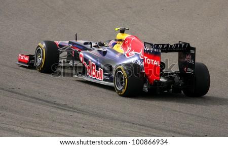 SHAKIR, BAHRAIN - APRIL 20: Mark Webber of Red Bull racing-Renault racing during Friday practice session in 2012 Formula 1 Gulf Air Bahrain Grand Prix on April 20, 2012 in Shakir, Bahrain - stock photo