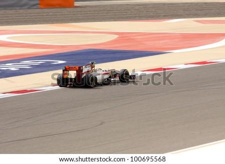 SHAKIR, BAHRAIN - APRIL 20: Narain Karthikeyan of HRT-Cosworth racing during Friday practice session in 2012 Formula 1 Gulf Air Bahrain Grand Prix on April 20, 2012 in Shakir, Bahrain - stock photo