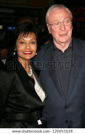 """Shakira Caine and Michael Caine at the World Premiere of """"The Prestige"""". El Capitan Theater, Hollywood, CA. 10-17-06 - stock photo"""