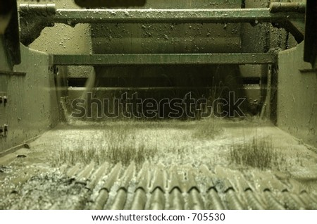 Shale shaker on an offshore oilrig in the North sea - stock photo