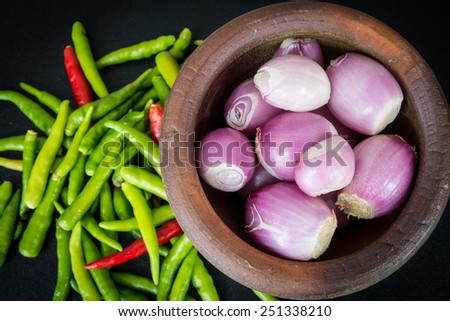 Shallots in mortar and chili - stock photo