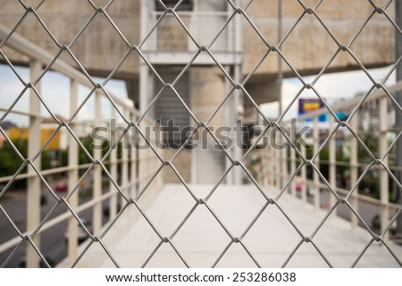 Shallow depth of field close-up of chain link fence - stock photo