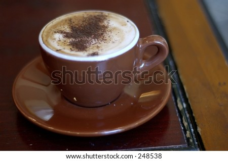 Shallow depth of field. Focus on chocolate powder in the middle of the cup. - stock photo