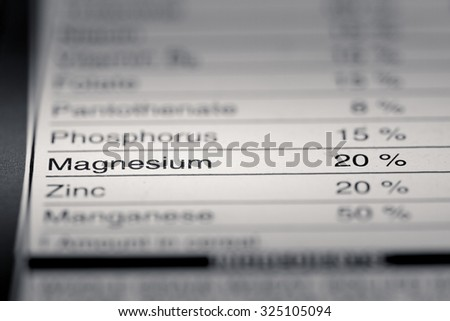 Shallow depth of Field image of Nutrition Facts Magnesium Information we can find on a grocery Store Product.