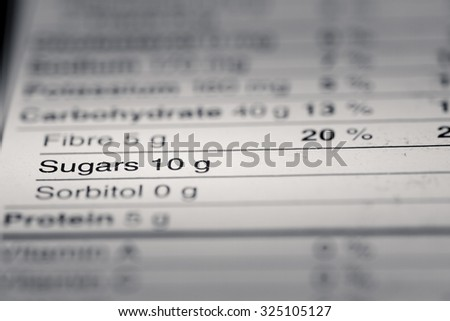 Shallow depth of Field image of Nutrition Facts Sugar Information we can find on a grocery Store Product.
