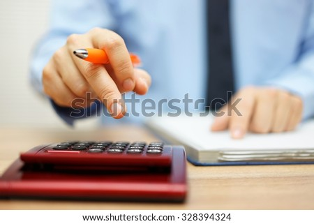 shallow depth of field of accountant calculating financial data - stock photo