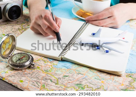 Shallow depth of field. Travel blogger coffee break. Notes Planning a trip.  White paper, where you can place your text or information - stock photo