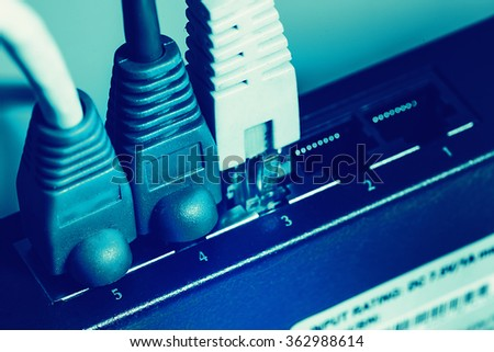 shallow DOF blue network cable with connectors - stock photo