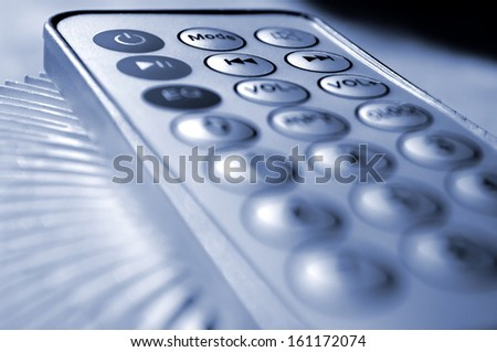 Shallow DOF composition with a remote control. - stock photo