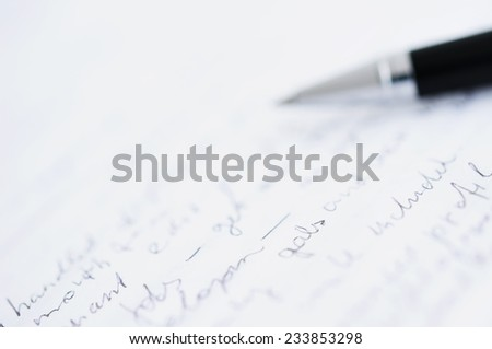 Shallow DOF photo of white paper with custom text and blurred ball pen - stock photo