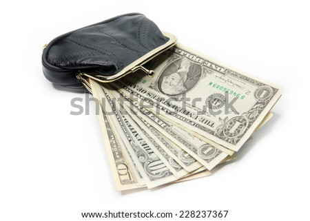 shallow paper dollars are in a black purse