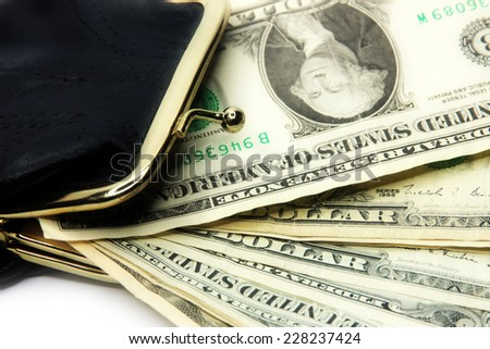 shallow paper dollars are in a black purse - stock photo
