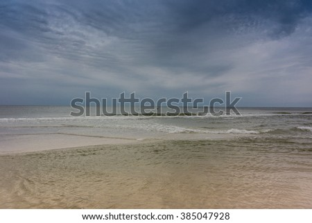 Shallow waters over a sand bar in the Gulf of Mexico along the Florida coastline - stock photo