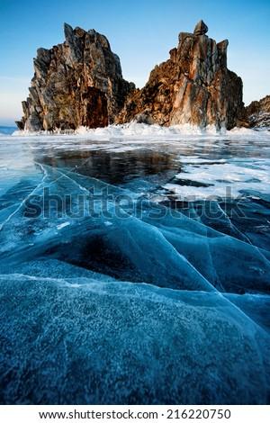 Shamanka Rock on the bank of winter Baikal - stock photo