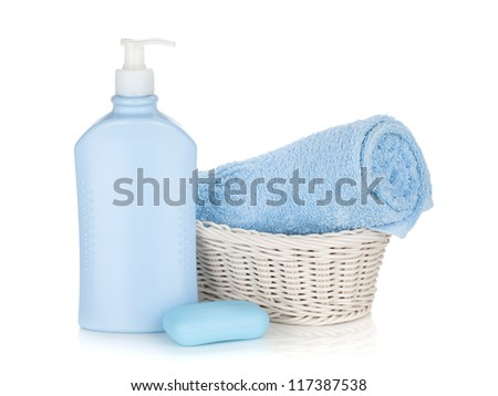 Shampoo bottle, soap and blue towel. Isolated on white background
