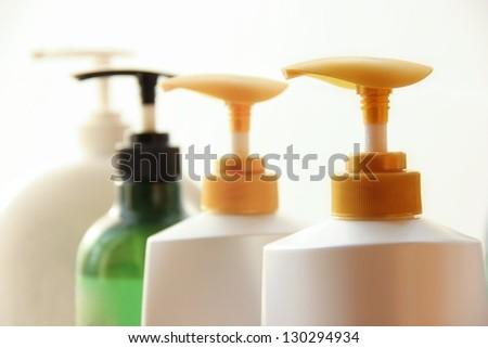 Shampoo bottles high key image. - stock photo