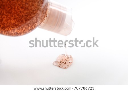 Shampoo containing plastic microbeads poured out from shampoo