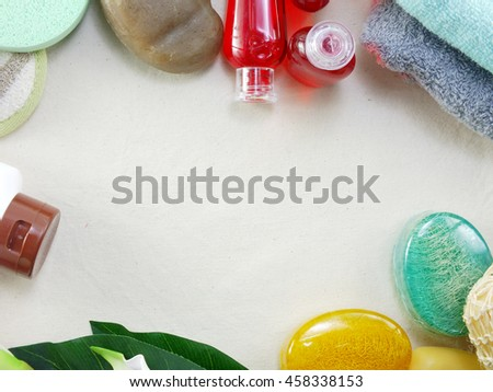 shampoo soap bar and liquid shower gel towels spa kit top view
