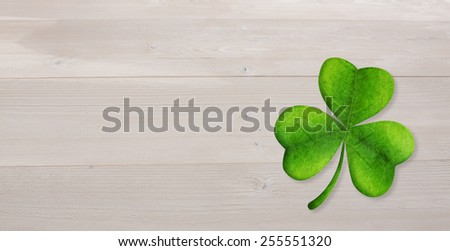 Shamrock against bleached wooden planks background - stock photo
