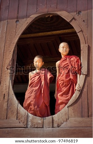 SHAN STATE, MYANMAR - NOV 22: unidentified young monks at the old teak wood Shwe Yan Pyay Monastery, this famous monastery was built by ancient Shan kings on Nov 22, 2011  Shan State, Myanmar