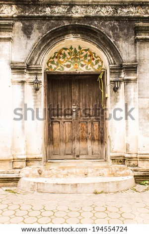 Shan style temple old door in Wat Papoa , Chiangmai Thailand - stock photo