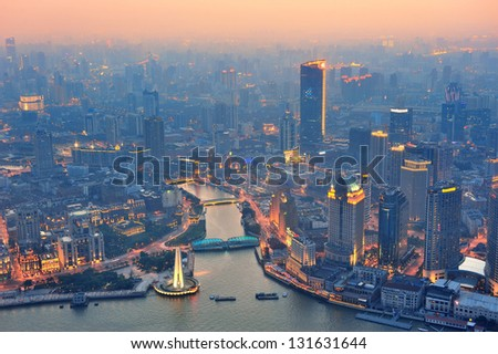 Shanghai aerial view with urban architecture and sunset - stock photo