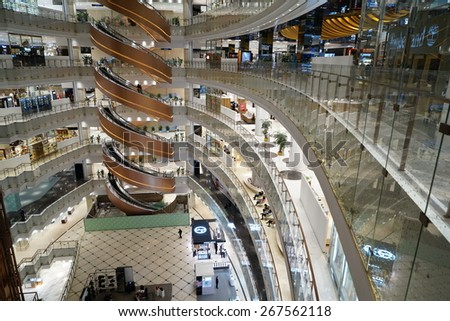 SHANGHAI-APR. 5, 2015. Luxury shopping mall interior. China accounts for about 20 percent, or 180 billion renminbi ($27 billion ) of global luxury sales in 2015, according to new McKinsey research.