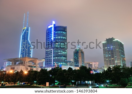 Shanghai at night with urban skyscrapers and lights