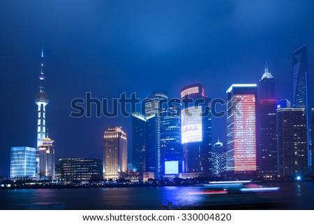 Shanghai Bund at night during blue hour, China - stock photo
