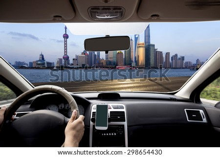 Shanghai car within view of the city skyline - stock photo