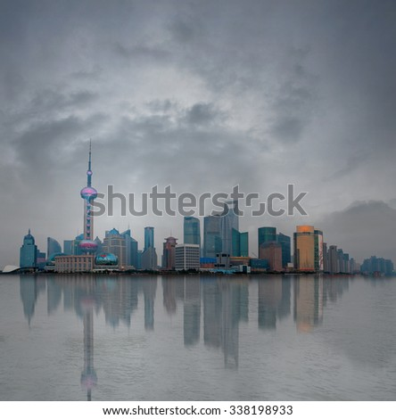 Shanghai center in smog, reflected in the water of Huangpu river
